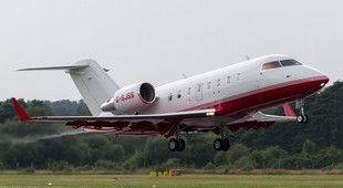 Bombardier Challenger 605 flying off of the runaway
