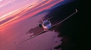 Gulfstream G100 Jet in the sky at sunset