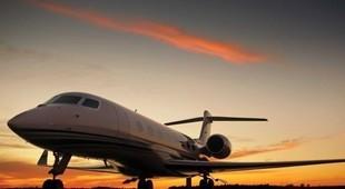 Gulfstream G650 on runway at sunset