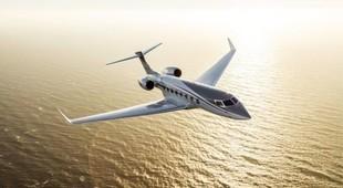 Gulfstream G650ER in flight above the sea