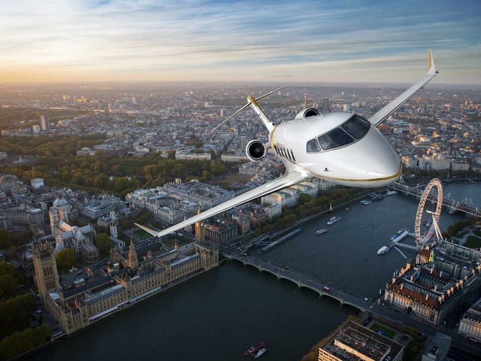 Bombardier Challenger 350 jet with city scape
