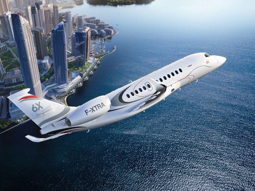 Dassault Falcon 6X Flies over City