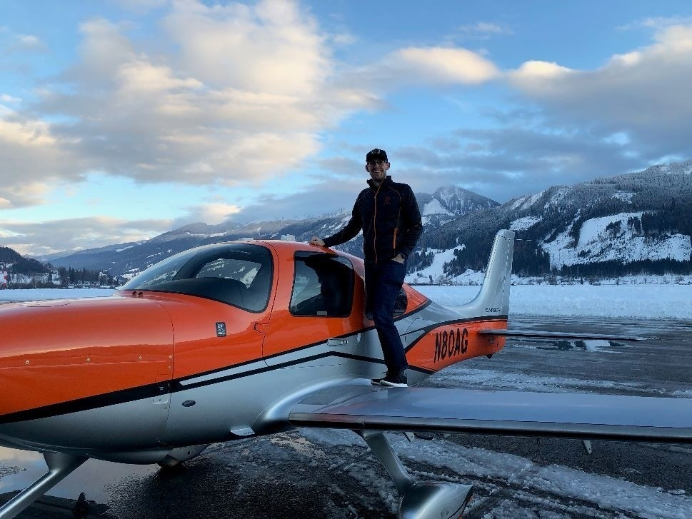 Andrew Gilbert with his Cirrus SR22 G6 Piston Single airplane