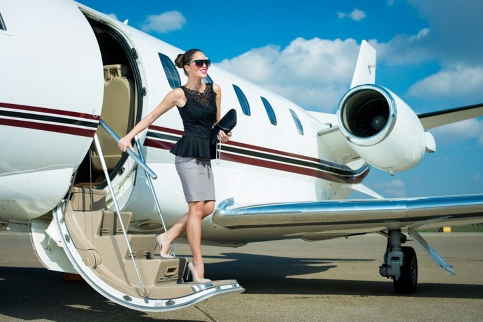 Business women getting off a private jet