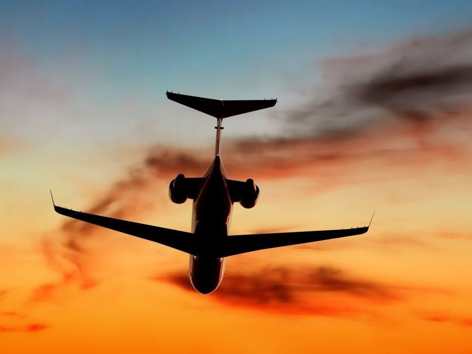 Private Jet Takes Off into the Sunset