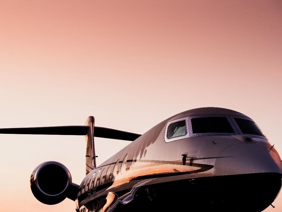 Private jet awaits clearance for take-off at dusk