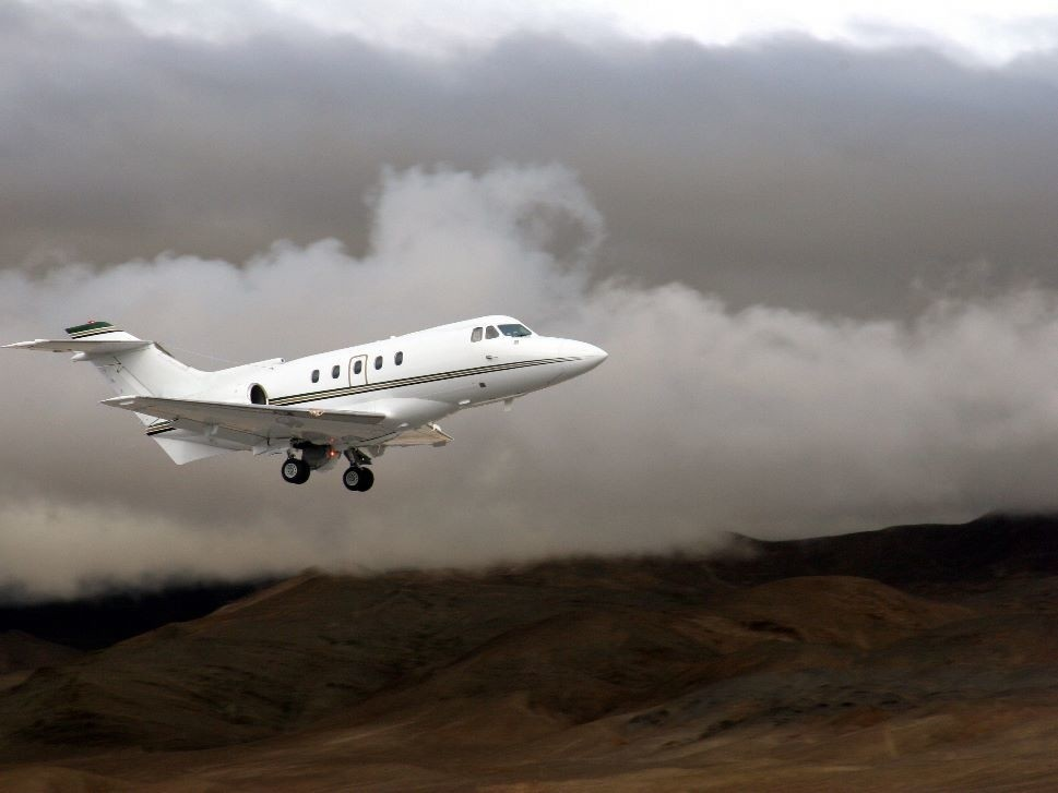 Private Jet Lands at a Mountain Airport