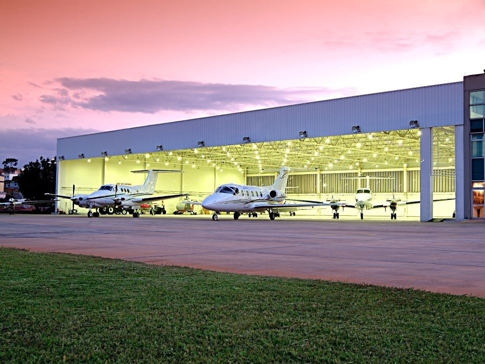 Private Jet and Turboprop Outside Hangar
