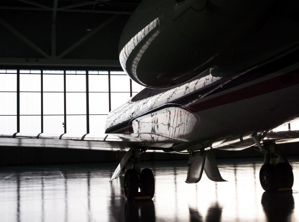Private jet in atmospheric hangar