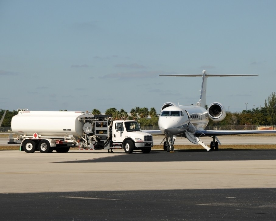 Private Jet receives fuel at the airport