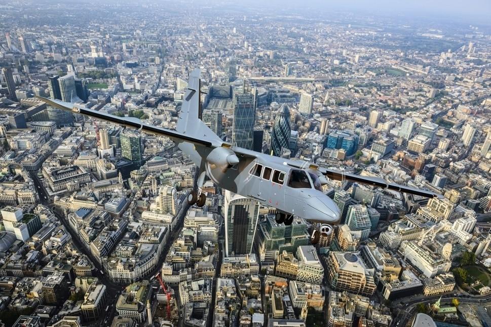 Britten-Norman Defender 4000 flies over London