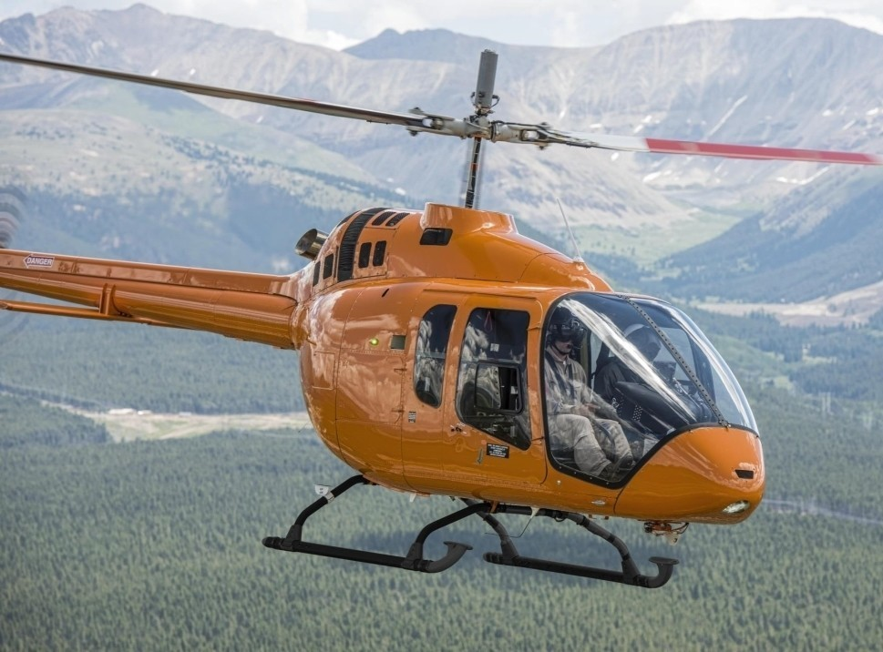 Bell 505 helicopter in flight