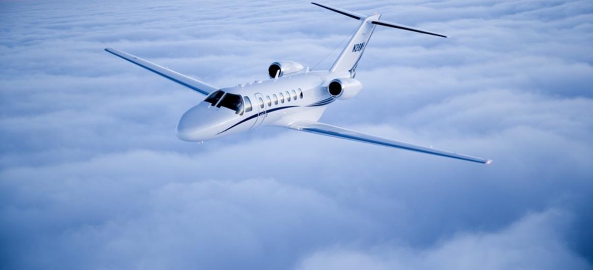 Cessna Citation CJ3 flying above clouds