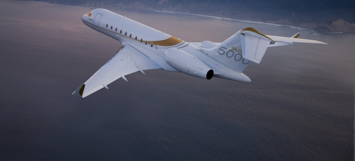 Global 5000 flying above mountains