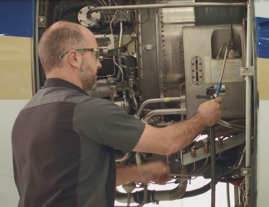 Performing a business jet engine oil service