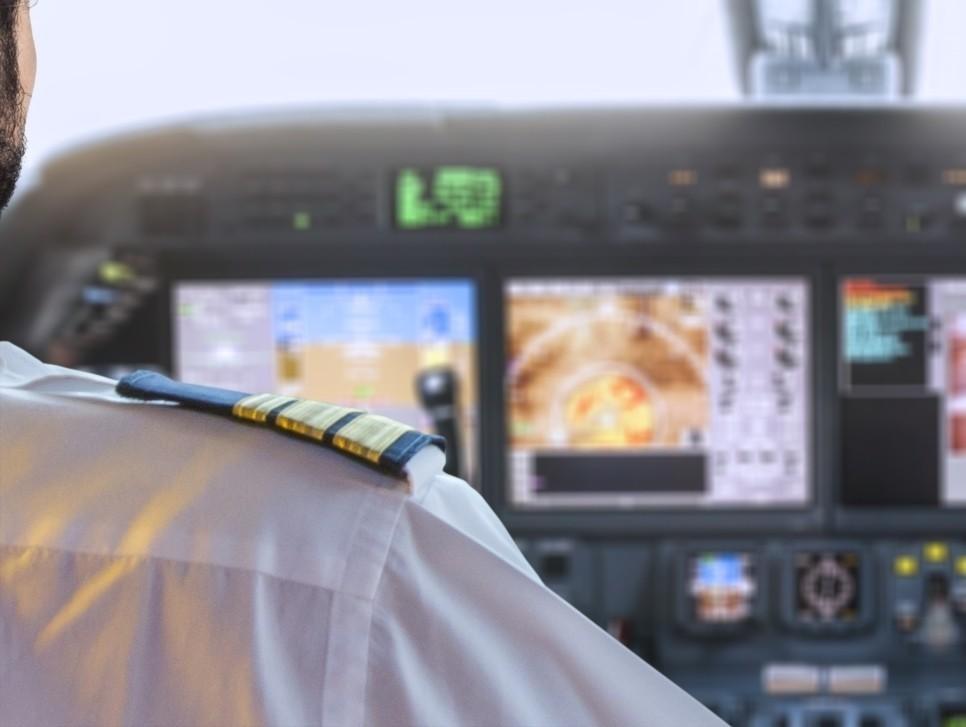 Over the Shoulder Pilot in Private Jet Cockpit