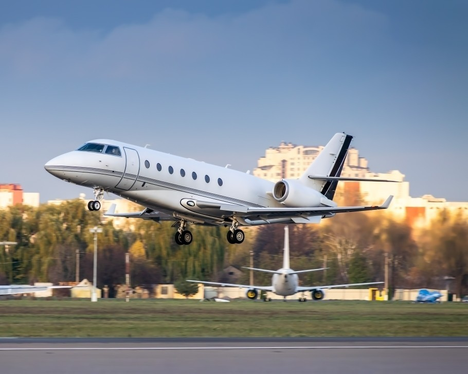 Private jet lands on airport runway