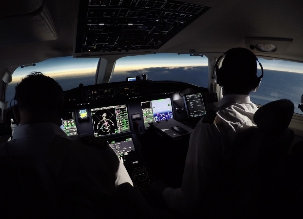 Two pilots fly a Dassault Falcon private jet