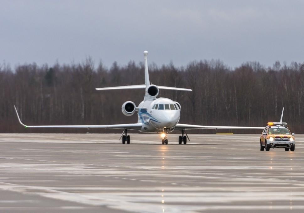 Dassault Falcon Jet Taxiing on Runway