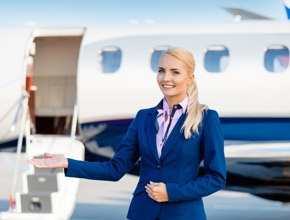 Air Stewardess Welcomes You Aboard Private Jet
