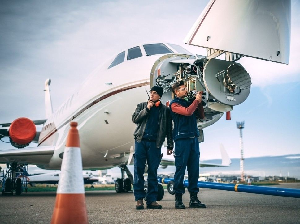 Aircraft Mechanics Work on Dassault Falcon Jet Nosecone