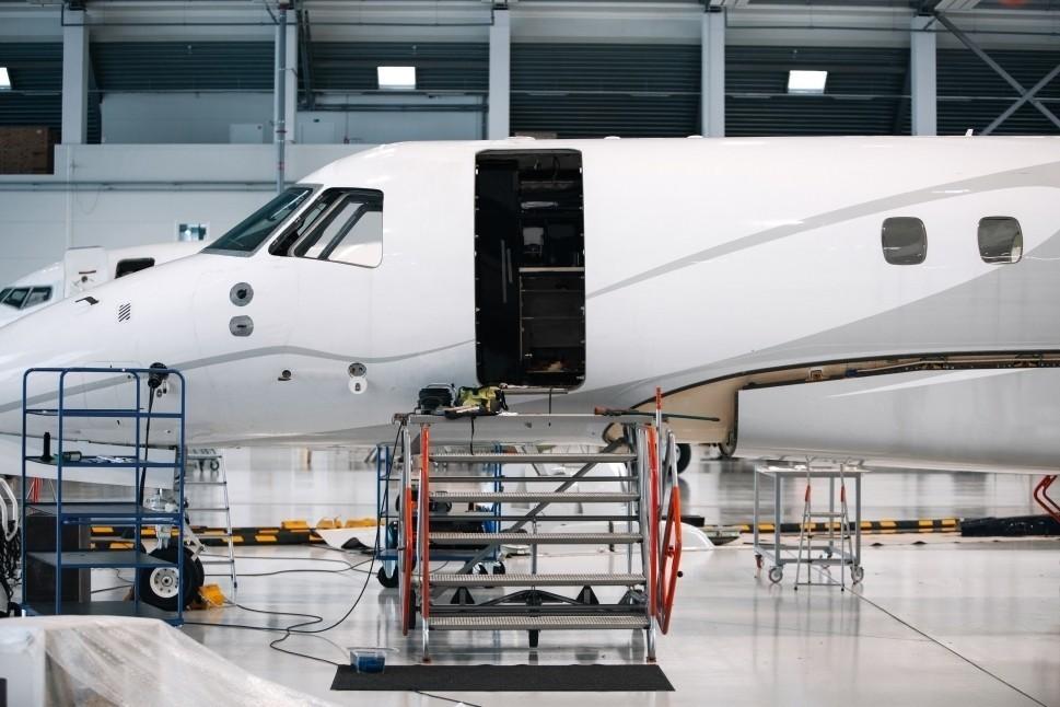 Private jet in hangar undergoing MRO work