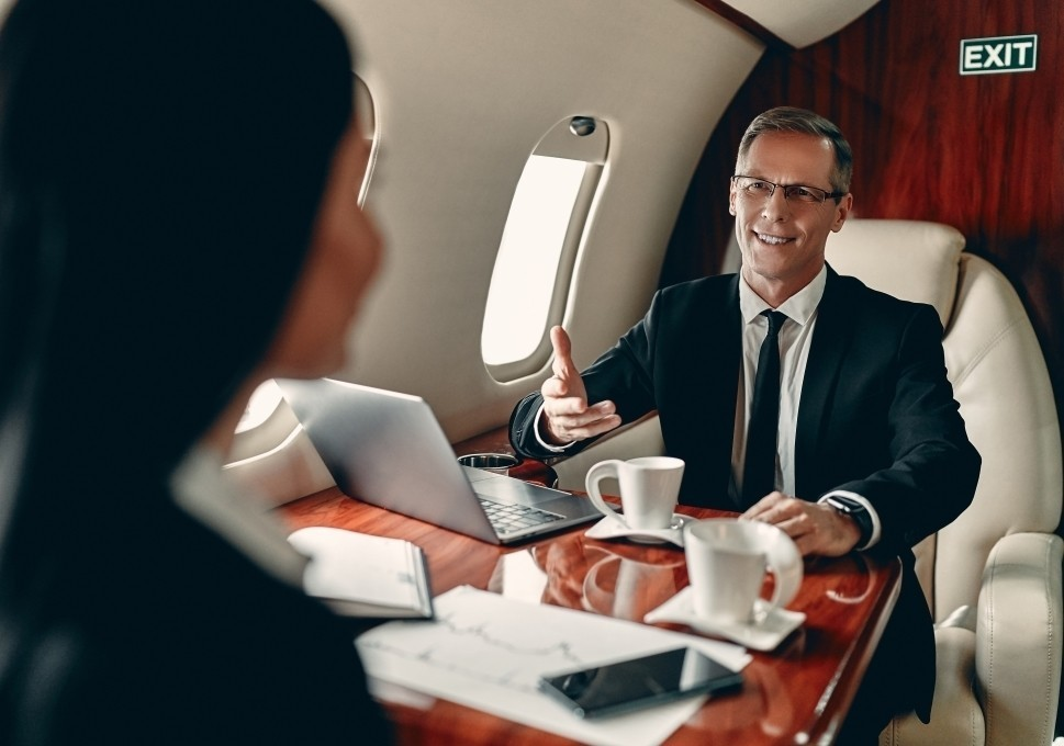 Executives Discuss Work Aboard a Private Jet