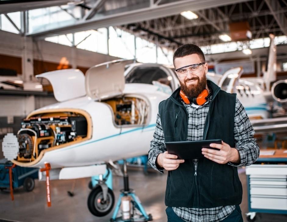 Cessna Citation private jet mechanic in maintenance hangar