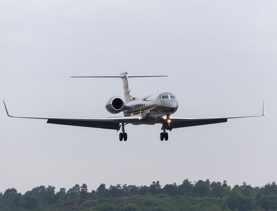A Gulfstream private jet lands at Farnborough Airport in the UK