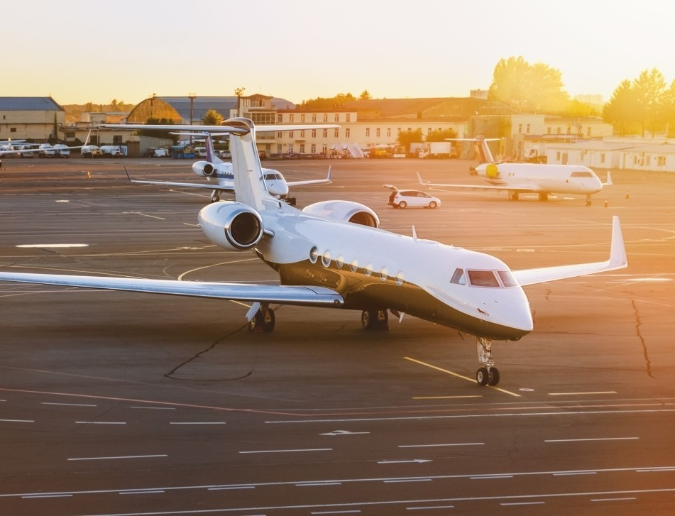 A Gulfstream private jet waits at dawn to pick up its passengers