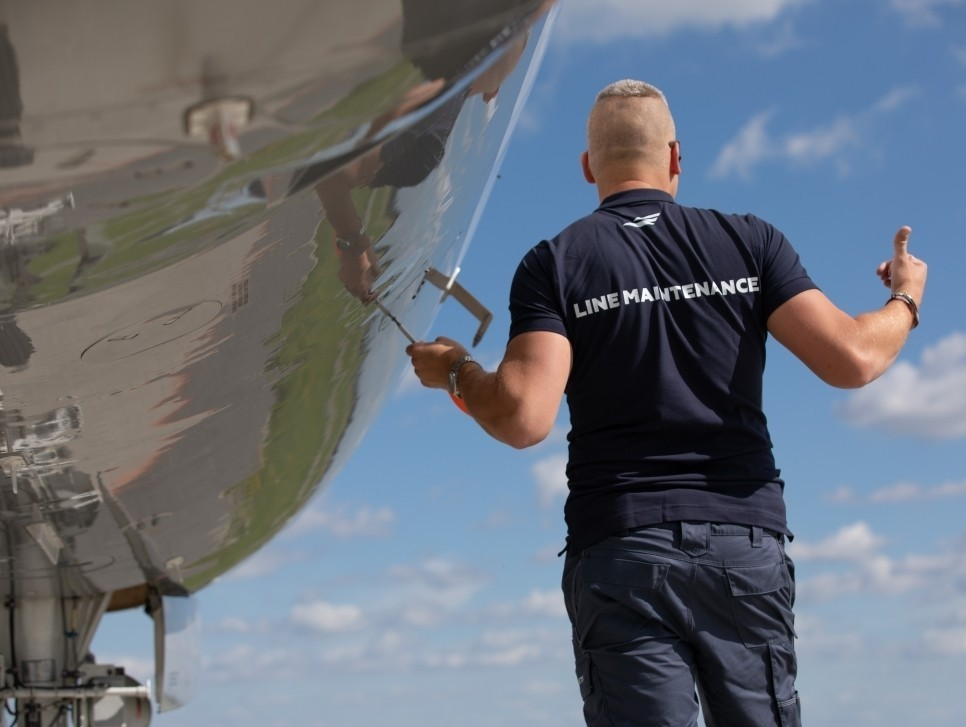 ABS Jets Line Maintenance Technician works on a private jet