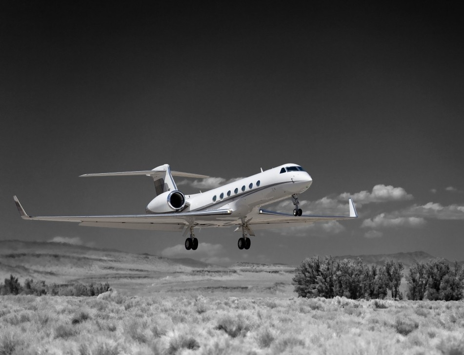 A Gulfstream business jet lands at a remote regional US airport