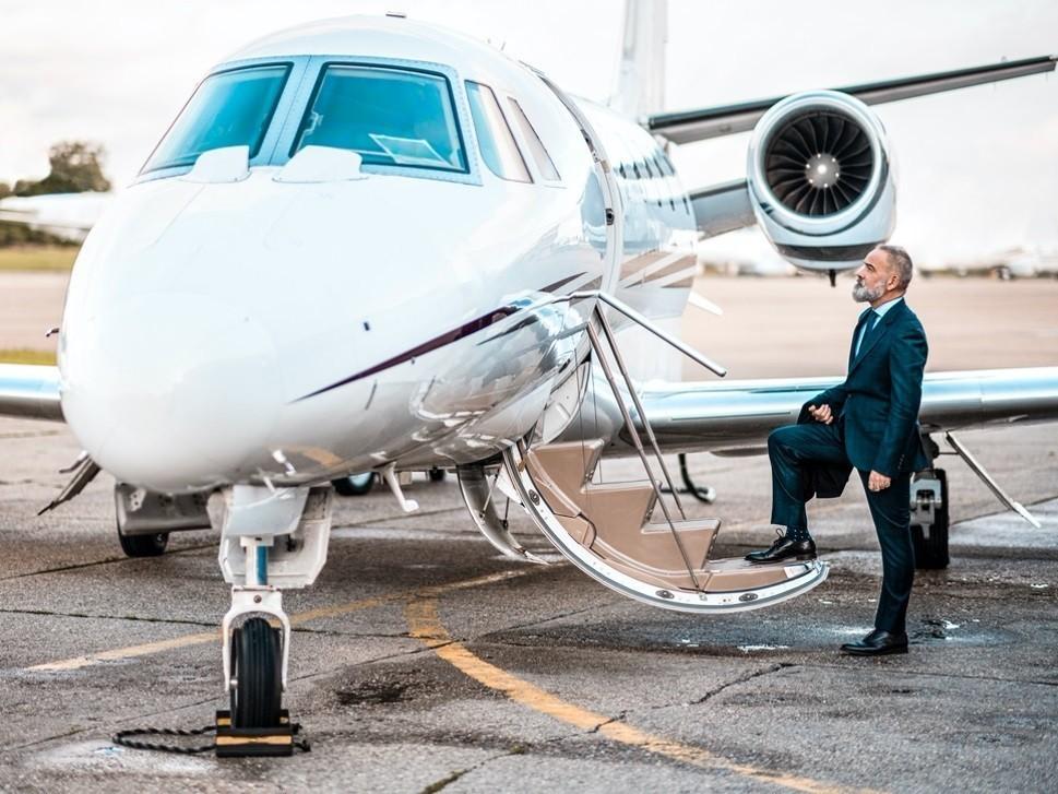 Executive climbs aboard a Cessna Citation private jet