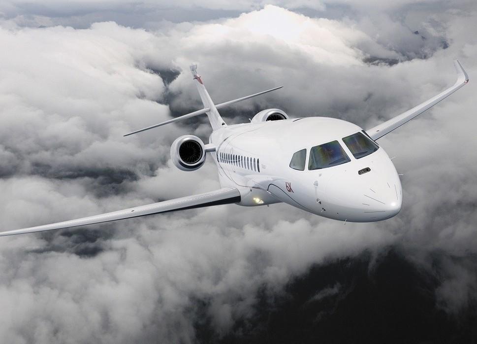Dassault Falcon 6X large jet flies above clouds