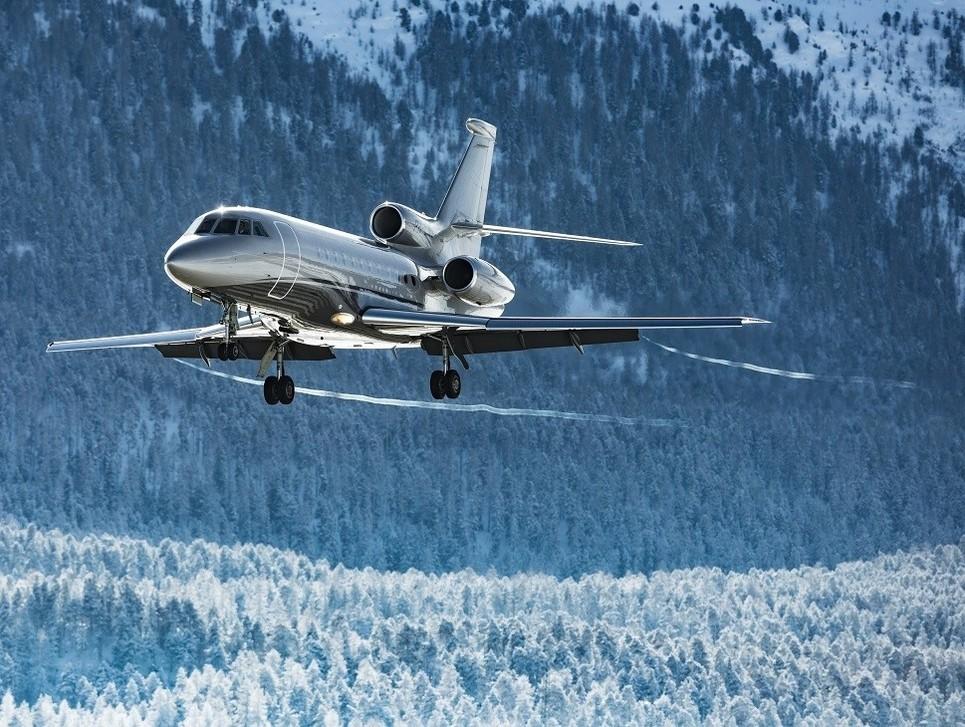 A Dassault Falcon jet lands at a mountain resort airport