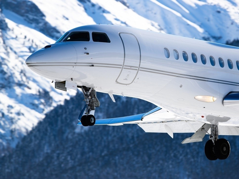 A Dassault Falcon business jet landing at a mountain airport