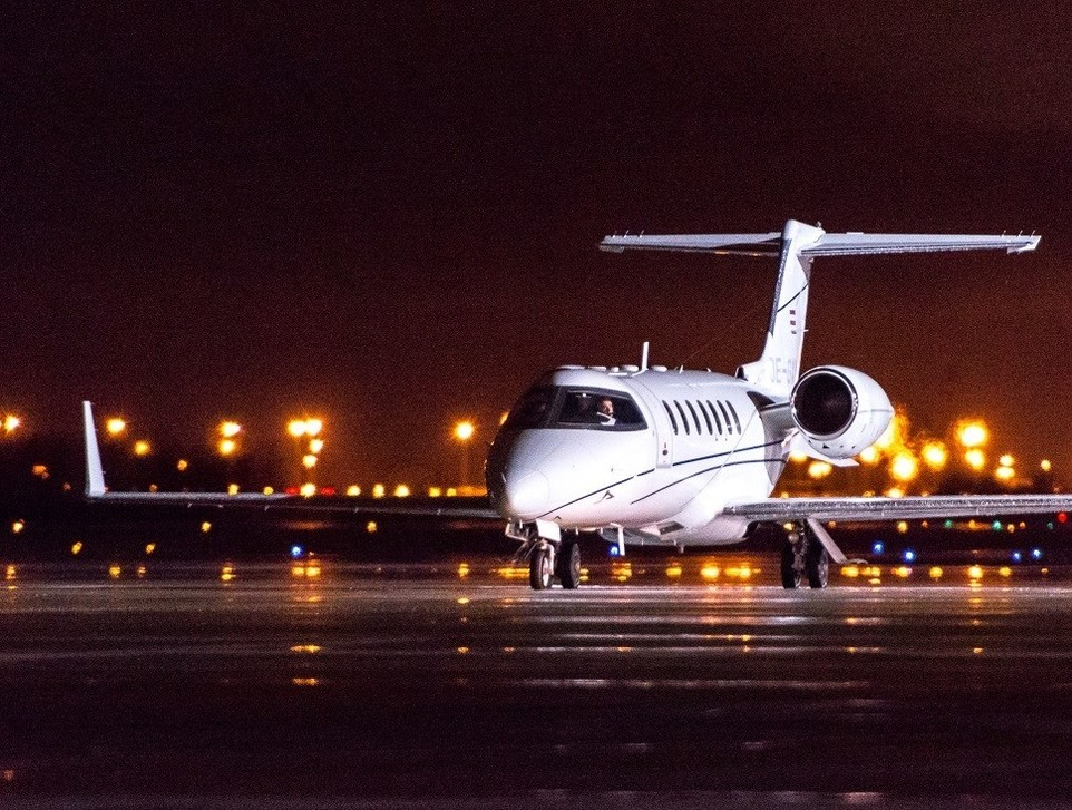 Bombardier Learjet 40 private jet at night time on airport ramp
