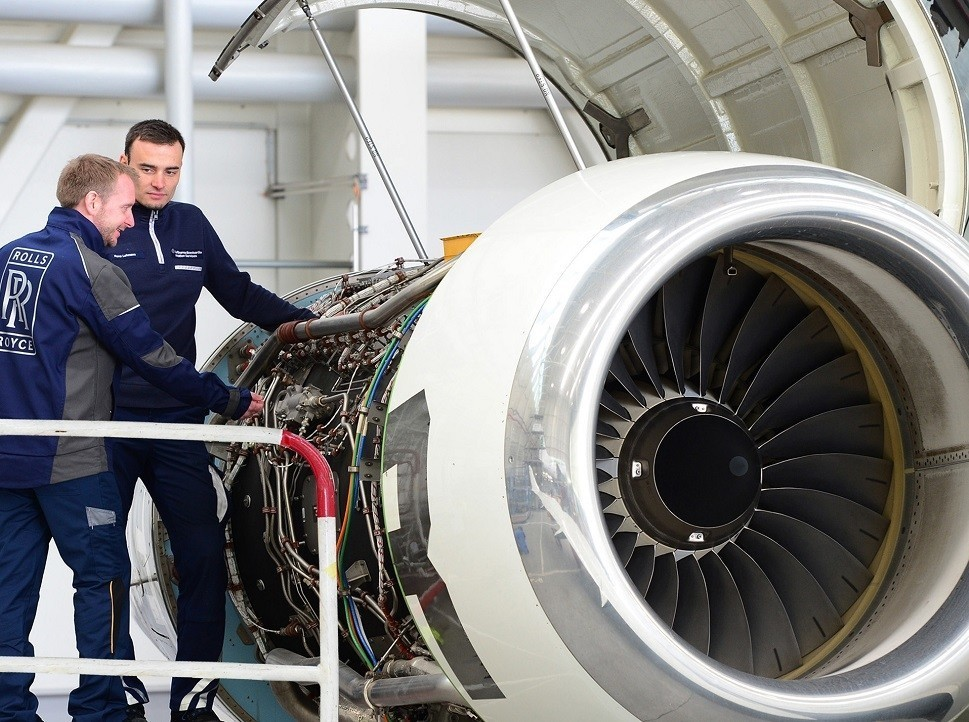 Rolls-Royce Technicians examine a private jet engine during overhaul
