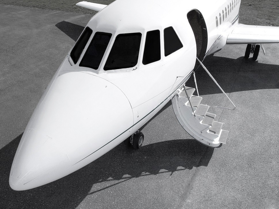 Dassault Falcon private jet nose cone and open stairway
