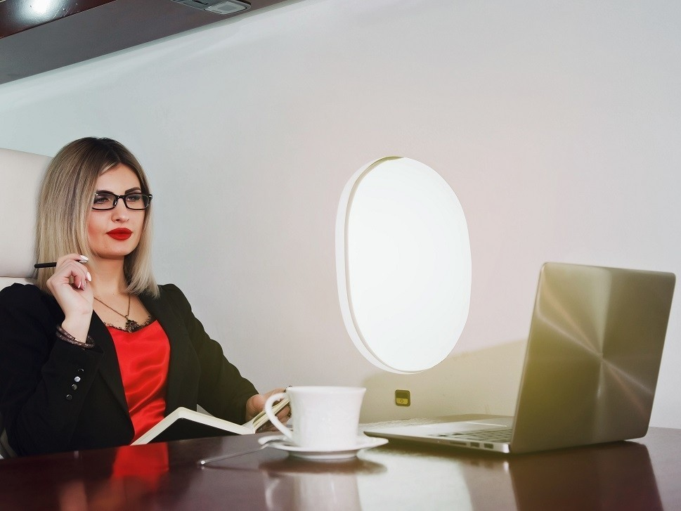 A savvy executive in the cabin of a private jet
