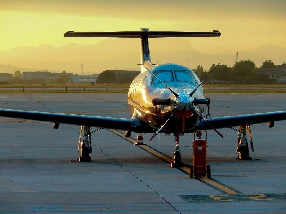 Pilatus PC-12 NG turboprop at a regional airport at sunset