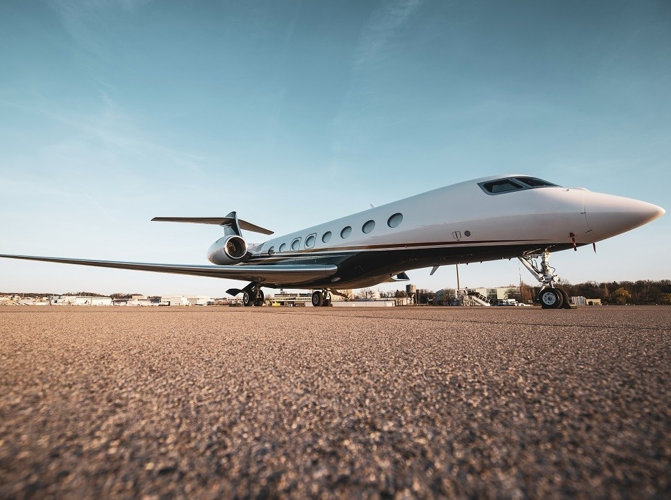 Gulfstream long-range private jet parked on airport ramp