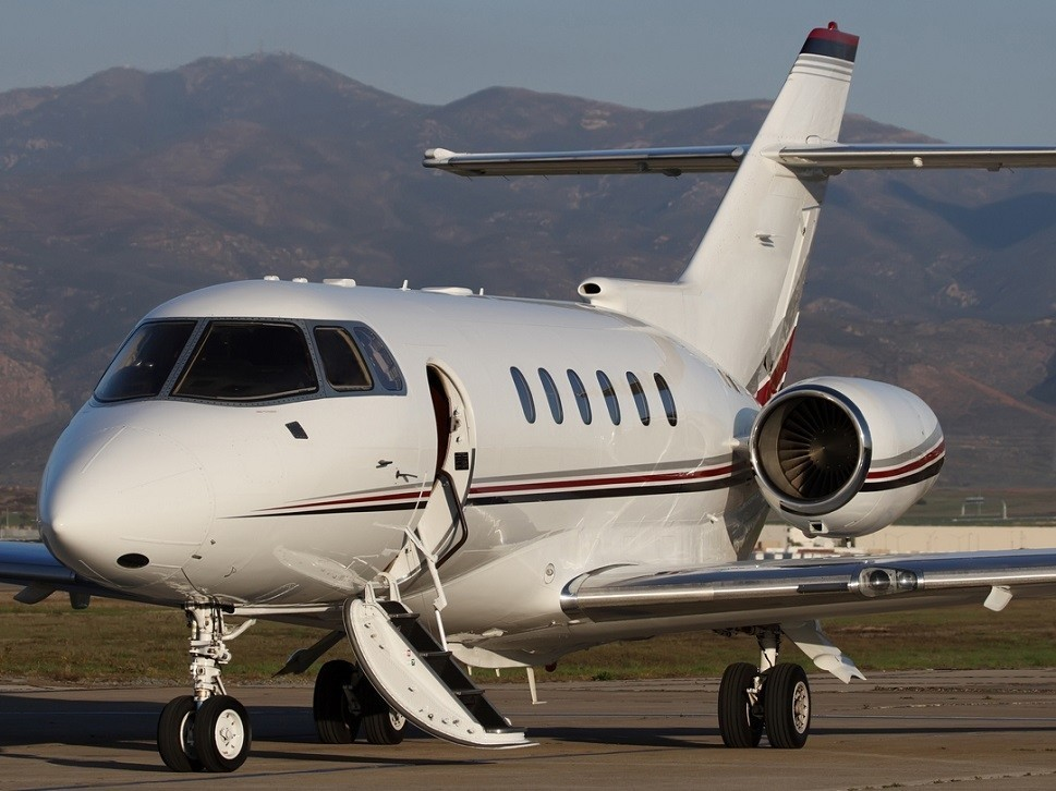 A Hawker 800-series Mid-Size Jet waits for passengers