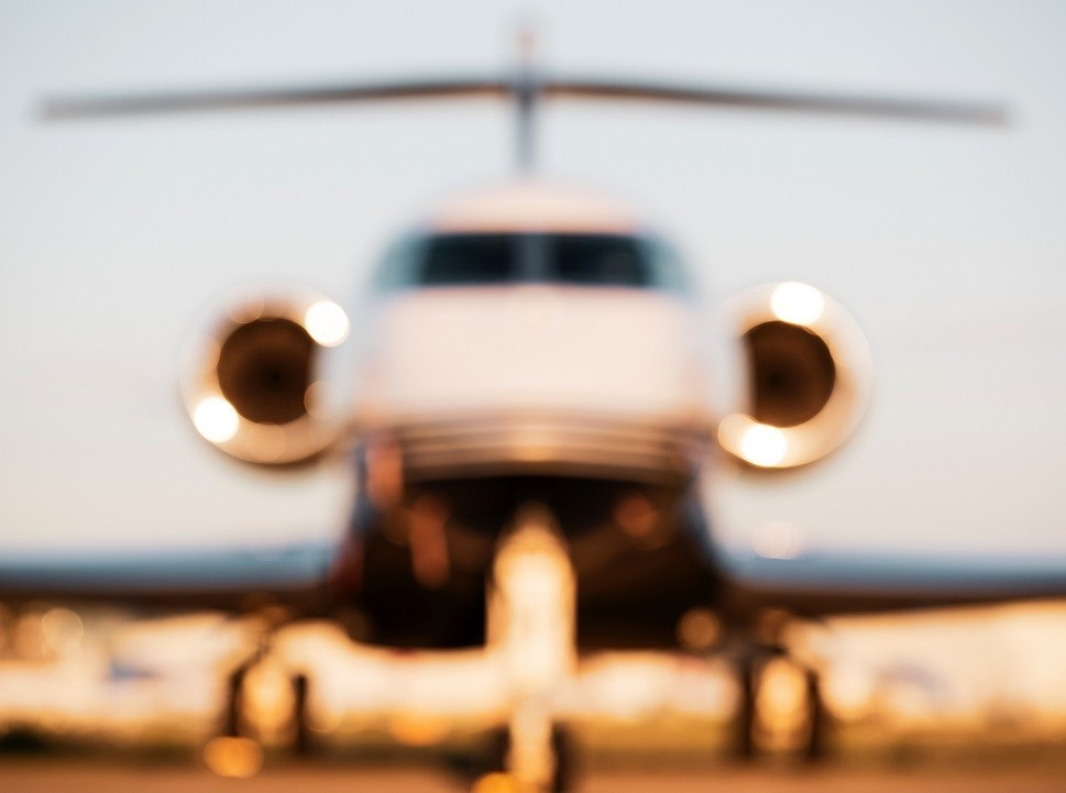 Blurred effect private jet parked on airport ramp