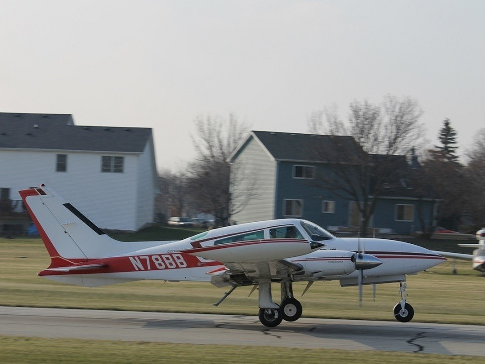 An N-registered twin piston Cessna 310 at the local airfield