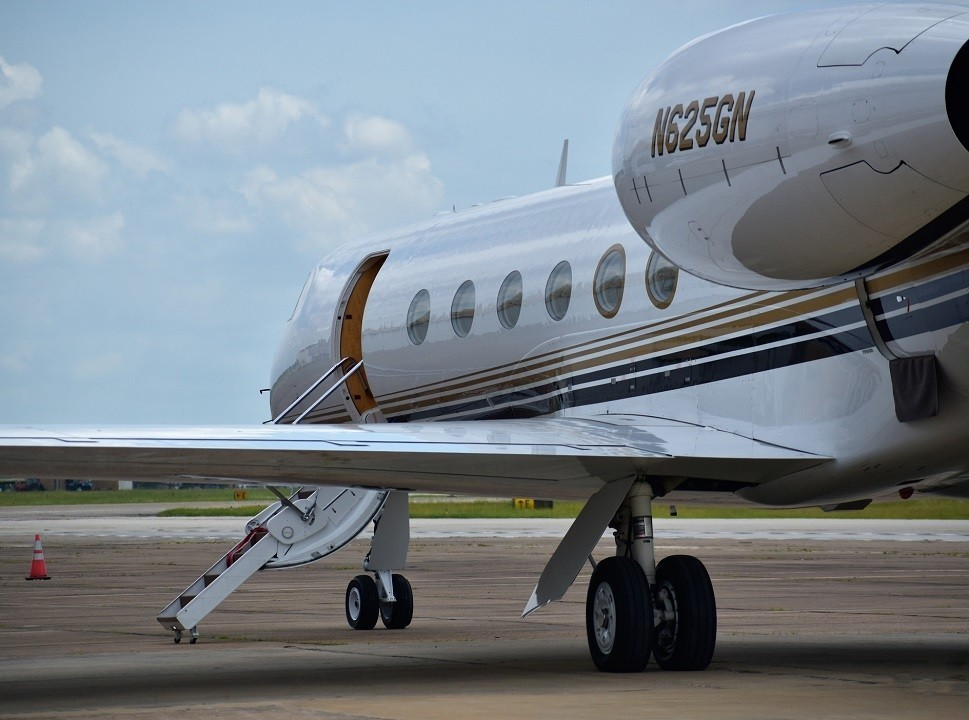 Gulfstream private jet with airstairs open for passenger pick-up