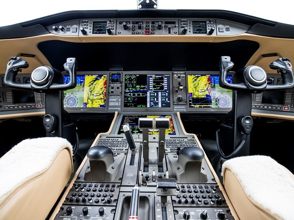 Modern private jet flight panel with avionics switched on
