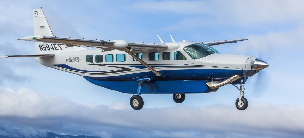Cessna Grand Caravan EX Flying over mountains