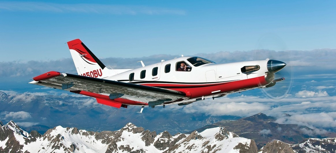 Daher TBM 850 flying over snowy mountains