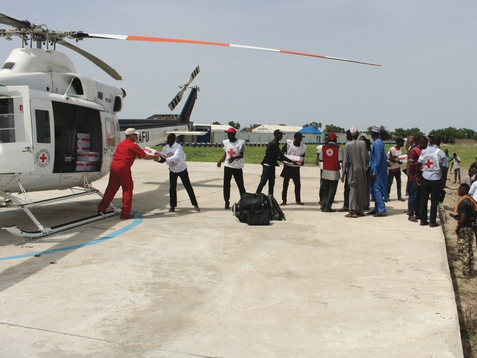 Medical supplies being unloaded off of a Helicopter